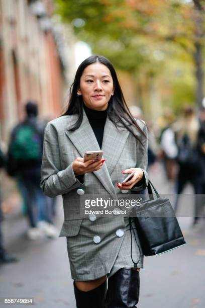 Tina Leung wears a blazer jacket black thigh high boots outside Valentino during Paris Fashion Week Womenswear Spring/Summer 2018 on October 1 2017...