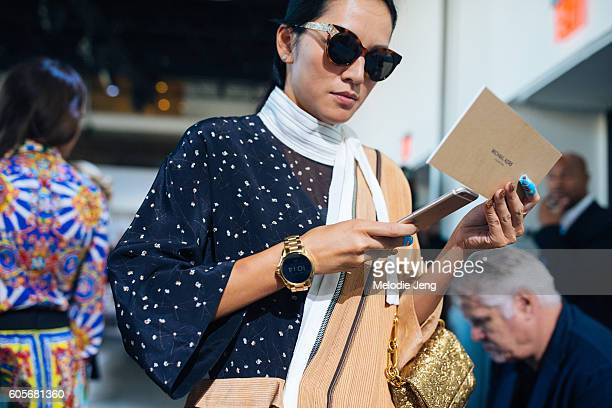 Tina Leung wears a Michael Kors Access Smart Watch at Spring Studios on September 14 2016 in New York City