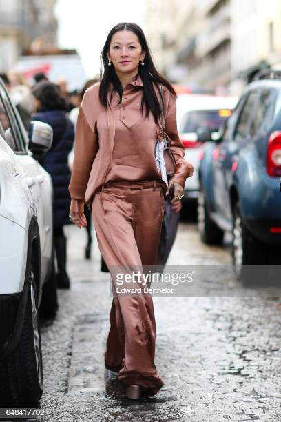 Tina Leung wears a pink shiny full outfit outside the Valentino show during Paris Fashion Week Womenswear Fall/Winter 2017/2018 on March 5 2017 in...