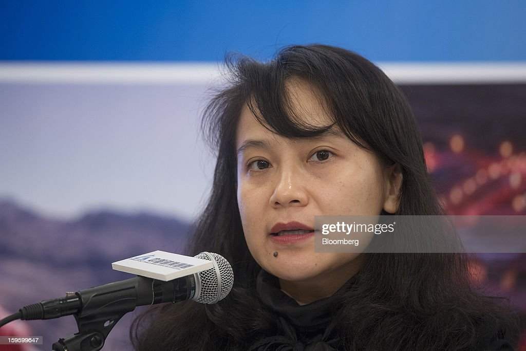 Tina Liang, chief financial officer of Chinalco Mining Corp. International, attends the company's initial public offering news conference in Hong Kong, China, on Thursday, Jan. 17, 2013. Chinalco Mining, a unit of China's biggest aluminum producer, plans to raise as much as $435 million in an initial public offering in Hong Kong to fund its copper project in Peru. Photographer: Jerome Favre/Bloomberg via Getty Images