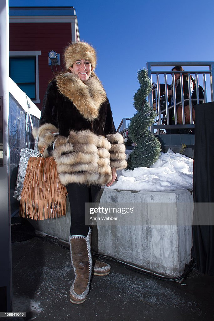 Tina Livanos, handbag designer from New York, wearing vintage fur hat, Maximilian fur coat, Livanou fringe bag, and Mou boots on January 20, 2013 on the streets of Park City, Utah.