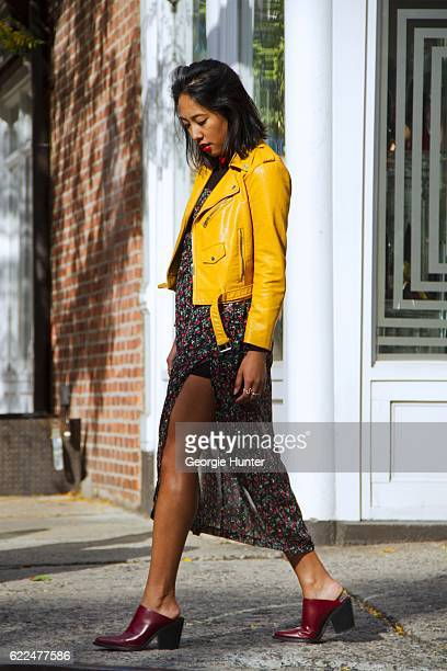 Tina Maria Tran with Urban Decay red lipstick wearing yellow pleather leather biker jacket with zips from Zara red and black sheer floral midi dress...