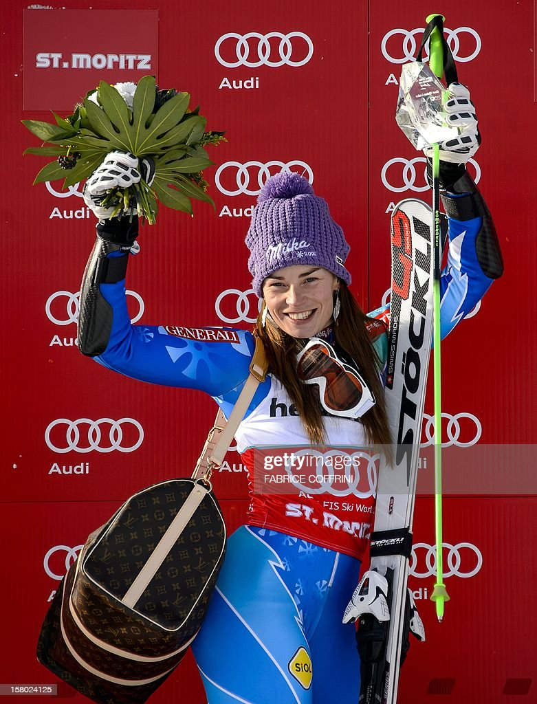 Tina Maze of Slovenia celebrates during the podium ceremony after winning the women's Alpine skiing World Cup giant slalom on December 9, 2012 in St. Moritz. Maze led by over half a second after the first run and held on to take top spot and 100 World Cup points ahead of Germany's Viktoria Rebensburg and Tessa Worley of France.