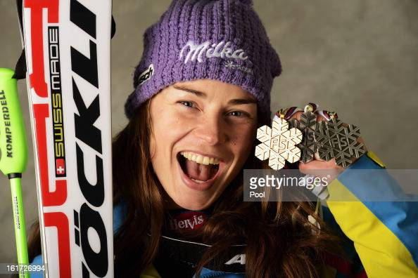 Tina Maze of Slovenia celebrates with her silver medals for finishing second in the Women's Giant Slalom and Women's Super Combined along with her...