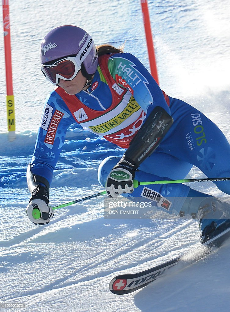 Tina Maze of Slovenia clears a gate during the first run of the women's World Cup giant slalom in Aspen on November 24, 2012. AFP PHOTO/Don EMMERT