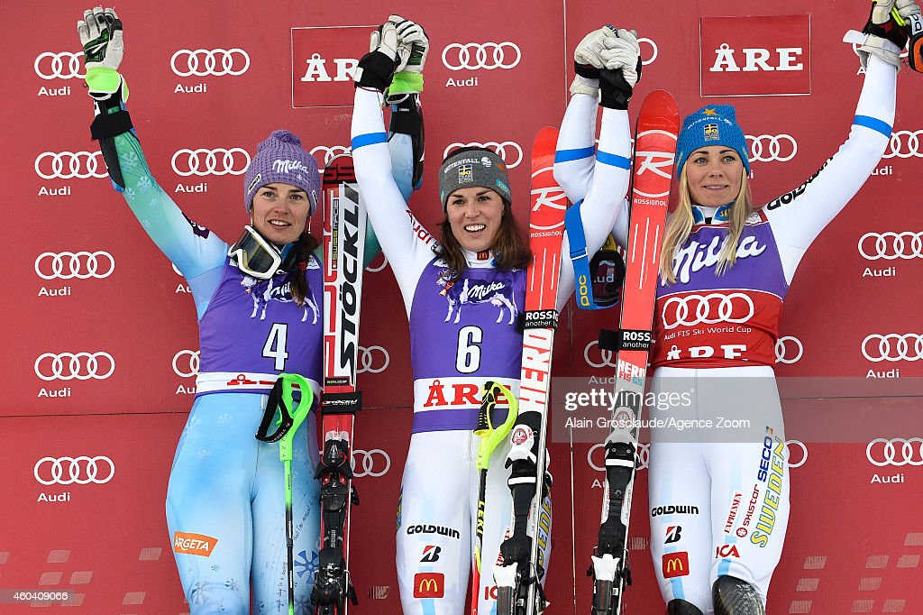 Tina Maze of Slovenia (2nd) ,Maria Pietilae-Holmner of Sweden (1st) and Frida Hansdotter of Sweden (3rd) celebrate on the podium after the Audi FIS Alpine Ski World Cup Women's Slalom on December 13, 2014 in Are, Sweden.