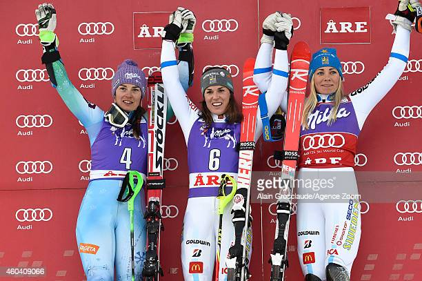 Tina Maze of Slovenia Maria PietilaeHolmner of Sweden and Frida Hansdotter of Sweden celebrate on the podium after the Audi FIS Alpine Ski World Cup...
