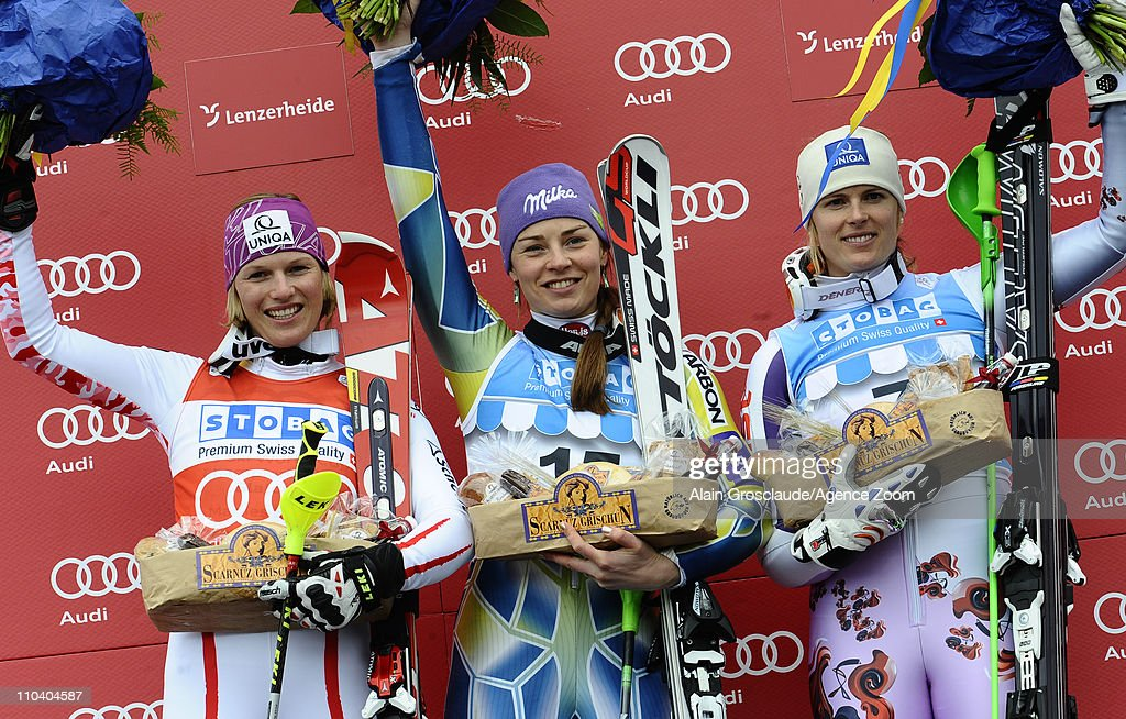 Tina Maze of Slovenia takes 1st place, Marlies Schild of Austria takes 2nd place, Veronika Zuzulova of Slovakia takes 3rd place during the Audi FIS Alpine Ski World Cup Women's Slalom on March 18, 2011 in Lenzerheide, Switzerland.