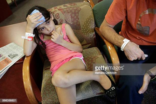 Tina Osborn waits with her Father Mustaf in the Emergency room of Scottsdale Healthcare Osborn Medical Center' in Phoenix AZ October 12 09 The story...
