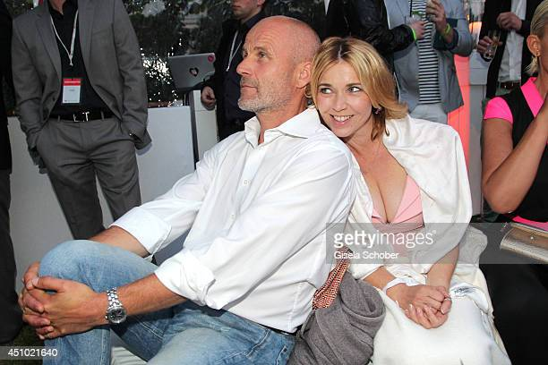 Tina Ruland and boyfriend Claus G Oldoerp attend the Raffaello Summer Day 2014 at Kronprinzenpalais on June 21 2014 in Berlin Germany