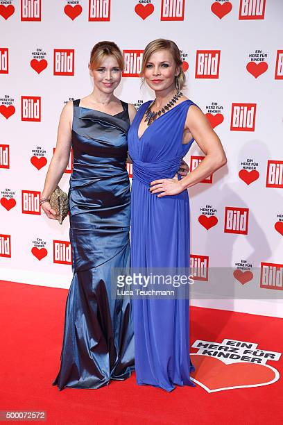 Tina Ruland and Regina Halmich arrive for the Ein Herz Fuer Kinder Gala 2015 at Tempelhof Airport on December 5 2015 in Berlin Germany