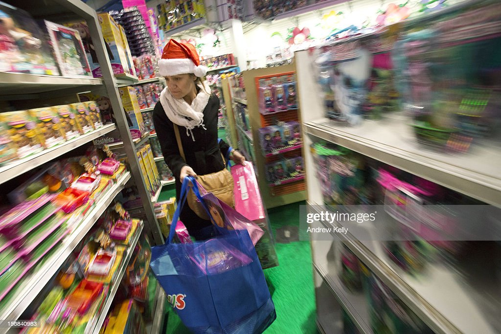 Tina Santiago makes her way theough the aisles at the Black Thursday sale at the Toys 'R' Us store in Times Square November 22, 2012 in New York City.The store got a head start on the traditional Black Friday sales by opening their doors at 8pm on Thanksgiving night.