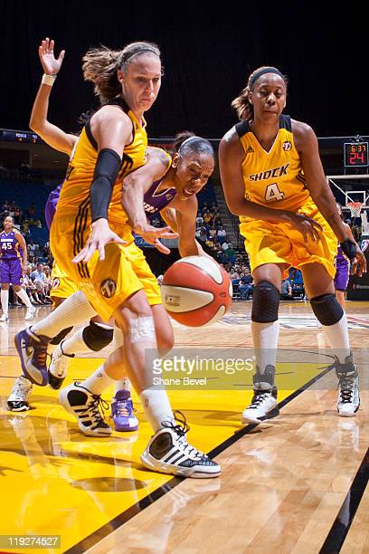 Tina Thompson of the Los Angeles Sparks battles for a loose ball with Kayla Pedersen and Amber Holt of the Tulsa Shock during the WNBA game on July...