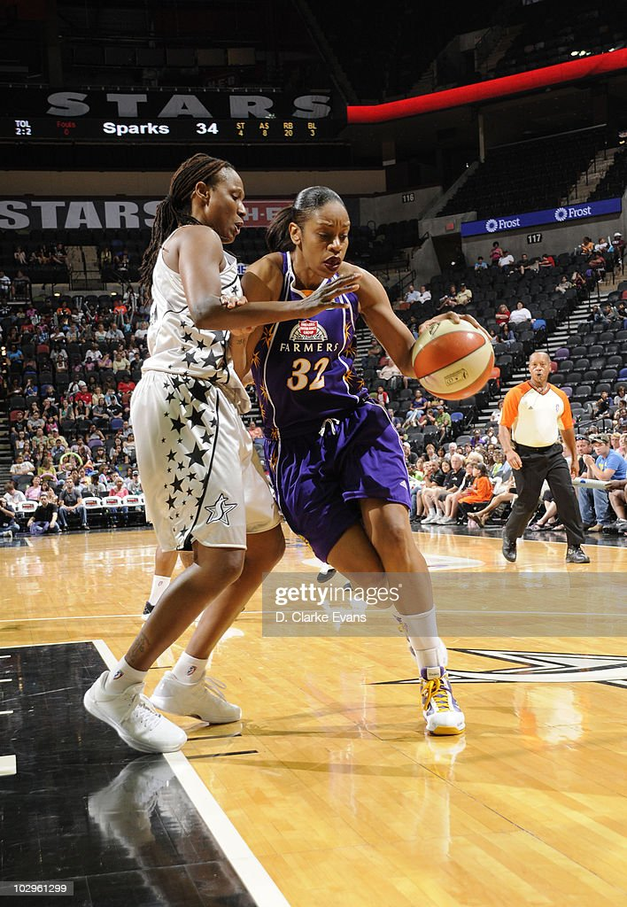 Tina Thompson of the Los Angeles Sparks drives to the basket as Chamique Holdsclaw of the San Antonio Silver Stars defend on July 18 2010 at the ATT...