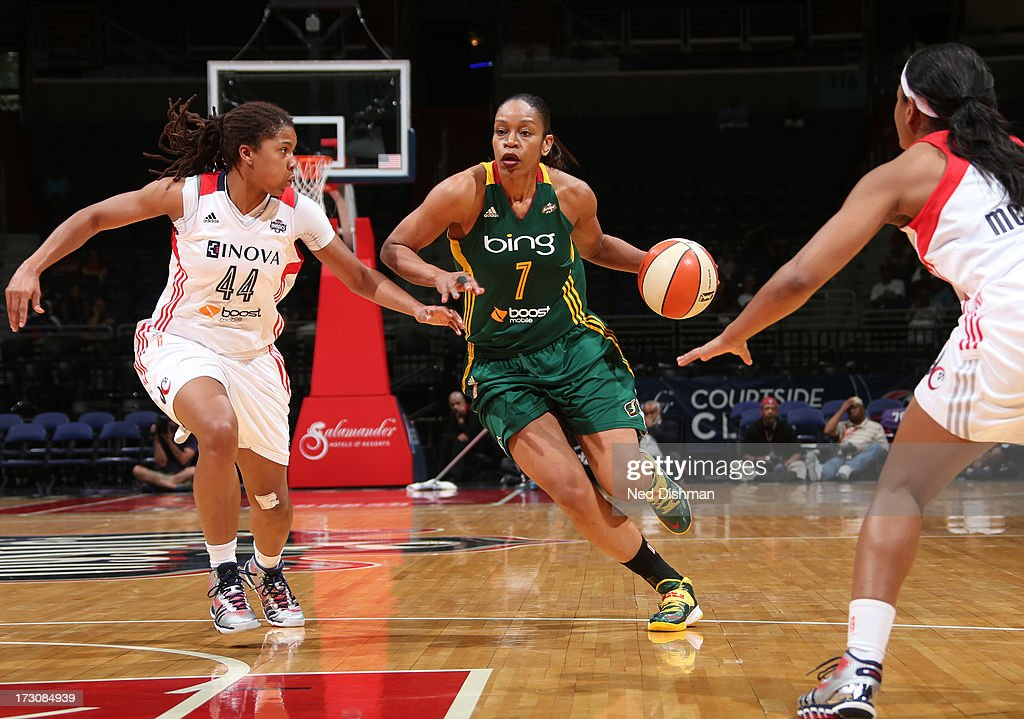 <a gi-track='captionPersonalityLinkClicked' href=/galleries/search?phrase=Tina+Thompson&family=editorial&specificpeople=206962 ng-click='$event.stopPropagation()'>Tina Thompson</a> #7 of the Seattle Storm drives against Tierra Ruffin-Pratt #44 of the Washington Mystics at the Verizon Center on July 6, 2013 in Washington, DC.