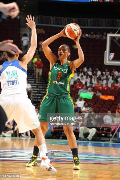 Tina Thompson of the Seattle Storm looks to pass the ball over Nicole Powell of the New York Liberty during a game on June 30 2012 at the Prudential...
