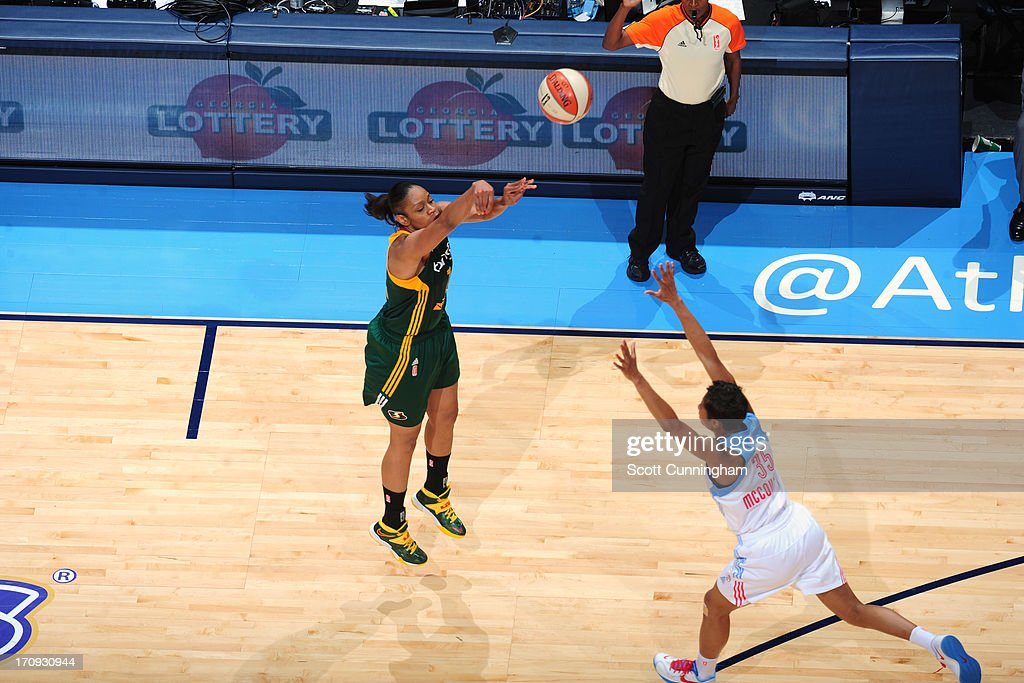 <a gi-track='captionPersonalityLinkClicked' href=/galleries/search?phrase=Tina+Thompson&family=editorial&specificpeople=206962 ng-click='$event.stopPropagation()'>Tina Thompson</a> #7 of the Seattle Storm shoots against the Atlanta Dream at Philips Arena on June 14, 2013 in Atlanta, Georgia.
