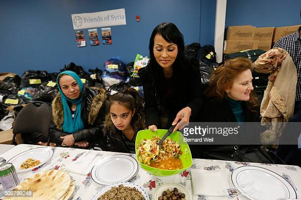 Tina Tran a refugee who came to Canada from North Vietnam thirty years ago helps Friends of Syria host a dinner for refugees at the Toronto Port...