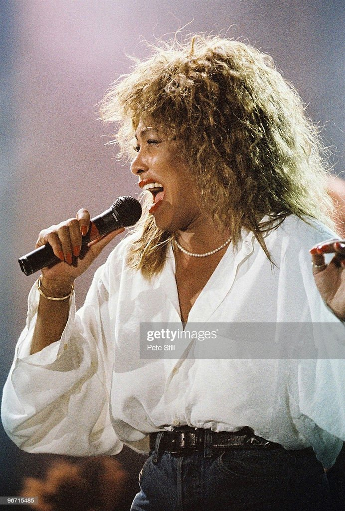 Tina Turner performs on stage on her 'Foreign Affair' tour, at Woburn Abbey on July 29th, 1990 in Woburn, United Kingdom.