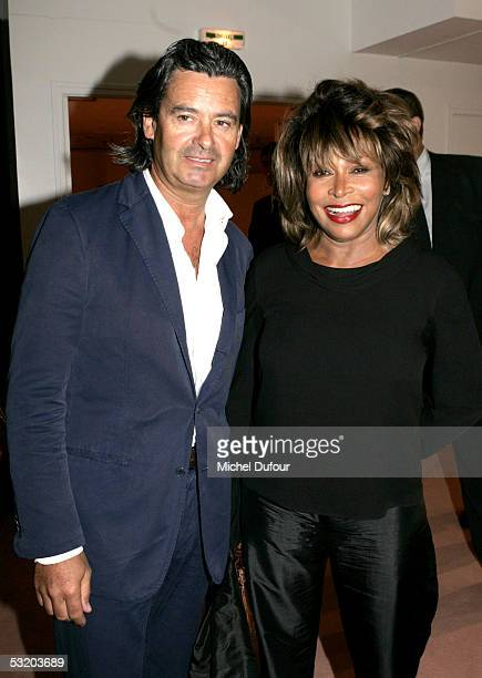 Tina Turner poses with an unidentified guest during Georgio Armani AutumnWinter 200506 Collection fashion show on July 6 2005 in Paris France