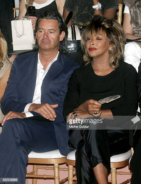 Tina Turner sits with an unidentified guest during Georgio Armani AutumnWinter 200506 Collection fashion show on July 6 2005 in Paris France
