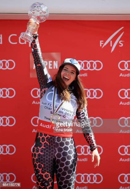 Tina Weirather of Liechtenstein celebrates with the globe after winning the overall title for the ladies' SuperG following the ladies' SuperG race...