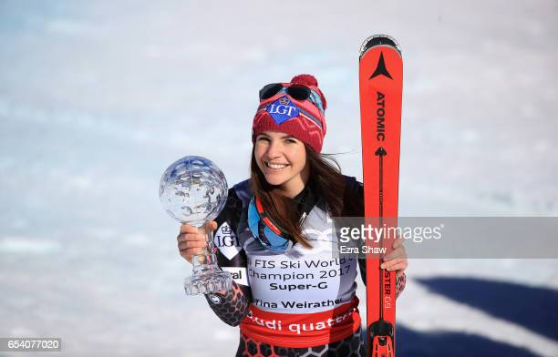 Tina Weirather of Liechtenstein smiles with the globe for winning the overall title for the ladies' SuperG following the ladies' SuperG during the...