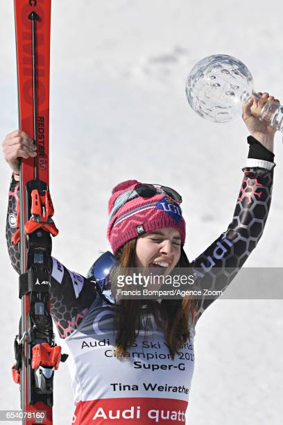 Tina Weirather of Liechtenstein wins the globe in the overall standings during the Audi FIS Alpine Ski World Cup Finals Women's and Men's SuperG on...