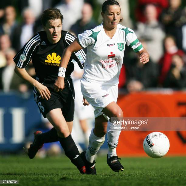 Tina Wunderlich of Frankfurt and Inka Grings of Duisburg in action during the Women's Bundesliga match between FCR 2001 Duisburg and 1 FFC Frankfurt...