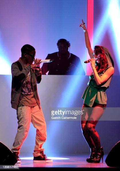 Tinchy Stryder and Amelle Berrabah perform at the launch of Vodafone London Fashion Weekend at Somerset house on February 23 2012 in London England