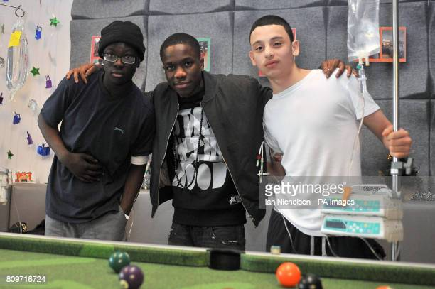 Tinchy Stryder meets 15yearold Ryan Asah left and 17yearold Brian AlansoSalcedo right during a preChristmas visit by the singer to teenage cancer...