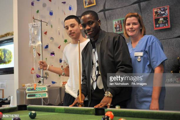Tinchy Stryder meets 17yearold Brian AlansoSalcedo left and staff nurse Gillian Brady during a preChristmas visit by the singer to teenage cancer...