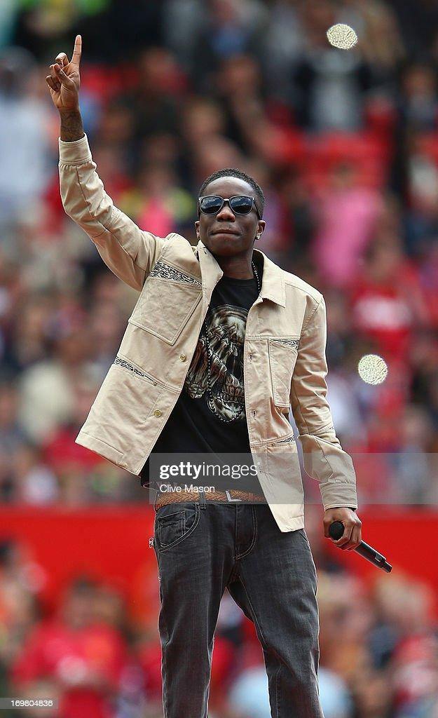 <a gi-track='captionPersonalityLinkClicked' href=/galleries/search?phrase=Tinchy+Stryder&family=editorial&specificpeople=4599337 ng-click='$event.stopPropagation()'>Tinchy Stryder</a> performs ahead of the match between Manchester United Legends and Real Madrid Legends at Old Trafford on June 2, 2013 in Manchester, England.