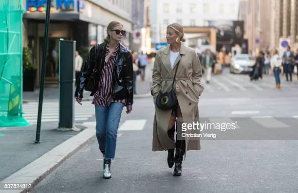 Tine Andrea and Janka Polliani wearing trench coat Loewe bag black overknees outside Line of Oslo on August 22 2017 in Oslo Norway