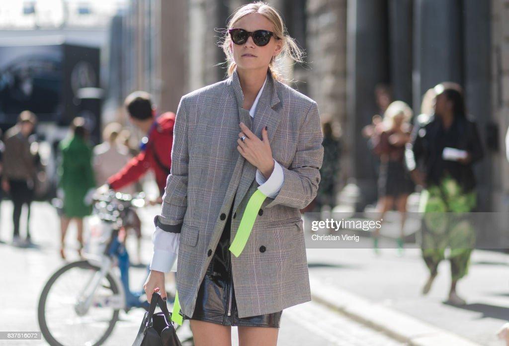 Tine Andrea wearing a grey blazer, black Loewe bag, black mini skirt outside Moods of Norway on August 22, 2017 in Oslo, Norway.