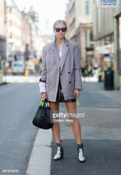 Tine Andrea wearing a grey blazer black Loewe bag black mini skirt outside Moods of Norway on August 22 2017 in Oslo Norway