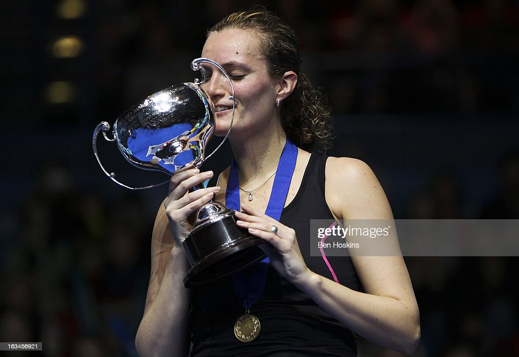 Tine Baun of Denmark celebrates with the trophy after defeating Intanon Ratchanok of Thailand in the final of the women's singles during Day 6 of the Yonex All England Badminton Open at NIA Arena on March 10, 2013 in Birmingham, England.