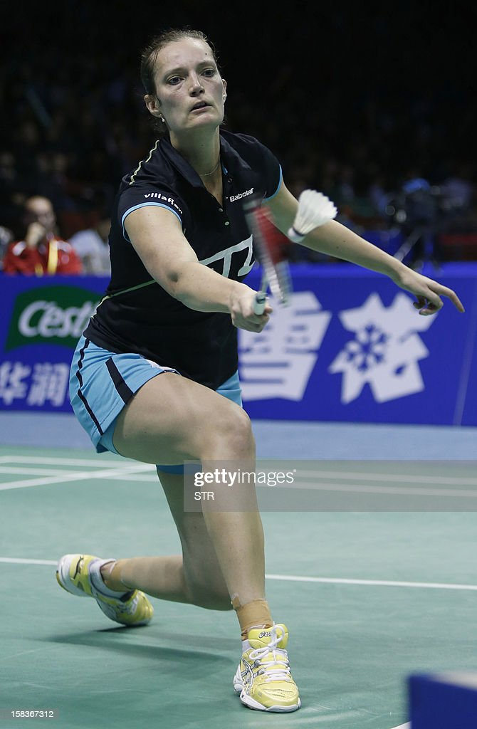Tine Baun of Denmark returns a shot against Ratchanok Intanon of Thailand in the women's singles event of the 2012 BWF Superseries Finals in Shenzhen, south China's Guangdong province on December 14, 2012. Ratchanok beat Baun 21-15, 21-14 to move into the next round.