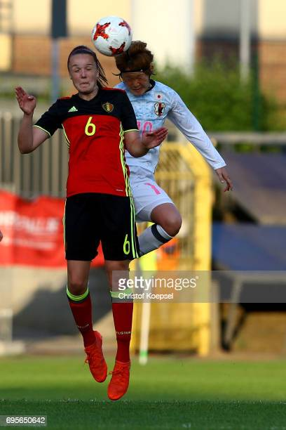 Tine De Caigny of Belgium and Mizuho Sakaguchi of Japan go up for a header during the Women's International Friendly match between Belgium and Japan...