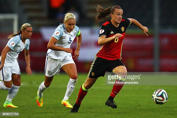 Tine De Caigny of the Belgium gets past the tackle from Steph Houghton of England during the UEFA Women's Euro 2017 Qualifier between Belgium and...
