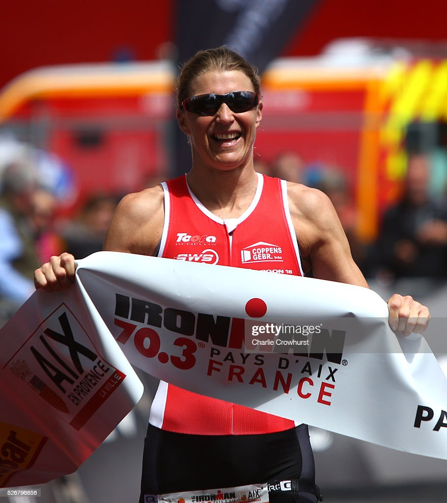 Tine Deckers of Belgium celebrates as she crosses the line in first place during Ironman 70.3 Aix en Provence on May 01, 2016 in Aix en Provence, France.