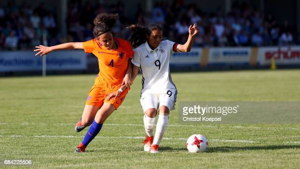 Tineke de Jong of the Netherlands challenges Gia Corley of Germany during the U15 girl's international friendly match between Germany and Netherlands...