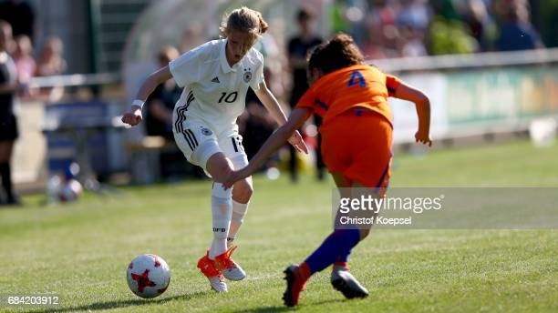 Tineke de Jong of the Netherlandsa Sophie Krall of Germany during the U15 girl's international friendly match between Germany and Netherlands at...