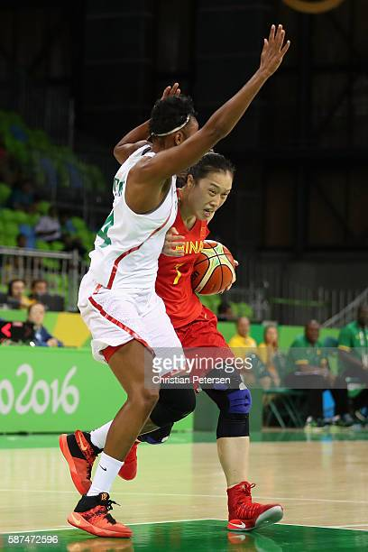 Ting Shao of China drives the ball against MarieSadio Rosche of Senegal during the women's basketball game on Day 3 of the Rio 2016 Olympic Games at...