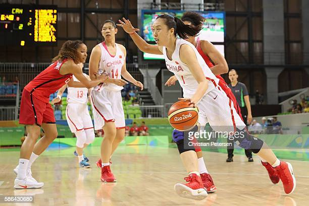 Ting Shao of China drives with the ball against Canada during a Women's Basketball Preliminary Round game on Day 1 of the Rio 2016 Olympic Games at...