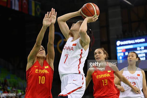 Ting Shao of China puts up a shot in front of Marta Xargay and Lucila Pascua of Spain in the Women's Basketball Preliminary Round Group B match...