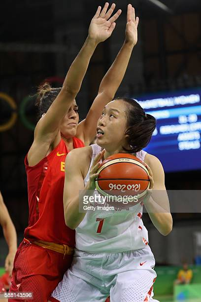 Ting Shao of China puts up a shot in front of Marta Xargay of Spain in the Women's Basketball Preliminary Round Group B match between China and Spain...