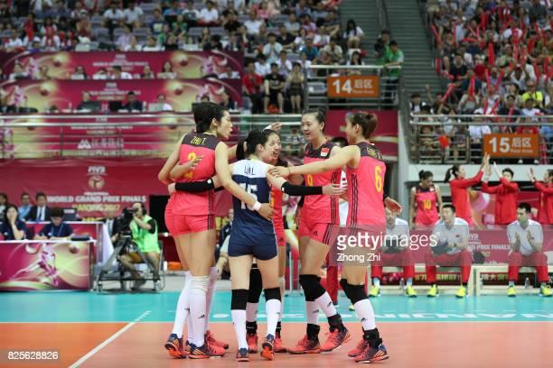 Ting Zhu #15 Li Lin #6 Xiangyu Gong #9 Changning Zhang #5 Yi Gao of China celebrate a point during the match between China and Brazil during Day 1 of...