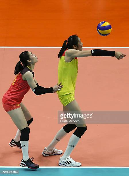 Ting Zhu and Li Lin of China in action during the women's qualifying volleyball match between the United States and China at the Maracanazinho...
