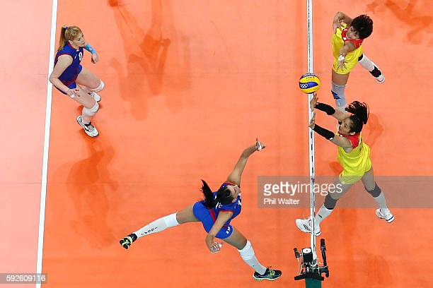 Ting Zhu of China blocks during the Women's Gold Medal Match between Serbia and China on Day 15 of the Rio 2016 Olympic Games at the Maracanazinho on...